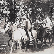 REAL PHOTO POSTCARD NATIVE AMERICAN BLACKFOOT WARRIORS ON HORSES BY PODOLL