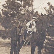 RPPC TWO SISTERS ON ROPING HORSE