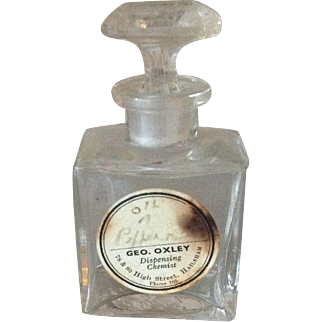 Antique Art Deco glass perfume bottle with original label