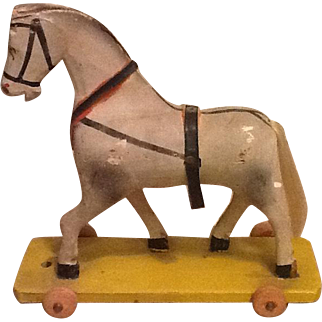 Antique small wooden horse on wheels. Ideal to display with small fashion dolls!