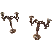 A pair of antique metal dolls house candelabras