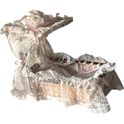 Antique small dolls bed/cradle with lace canopy late 19th century and bisque doll