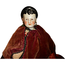 Snooty Brunette China Head Doll