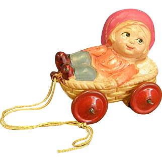 Darling Little Celluloid Pull Toy with Metal Wheels