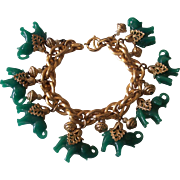Fabulous NAPIER Green Elephant Charm Bracelet in Gold tone