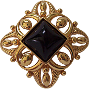 Monet Gold tone Black Lucite Brooch