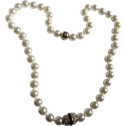 Fabulous Strand of Pearls (faux) with Emerald Baguette Rhinestone Enhancer