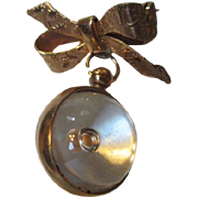 Vintage Mustard Seed Pin in Orb hanging from Bow Pin
