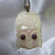 Fabulous Carved Mother of Pearl Asian Goddess with Genuine Ruby eyes Pendant