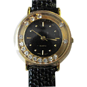 Elegant Vintage Avon Watch with Moving Rhinestone Bezel Black Leather Strap NOS