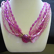 Fun and Funky Purple Seven Strand Early Plastic Faceted Round Clasp Vintage Necklace