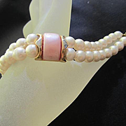 Lovely Napier signed Double Strand fx Pearls Pink Thermoset center Vintage Bracelet