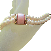 Lovely Napier signed Double Strand fx Pearls Pink Thermoset center Vintage Bracelet