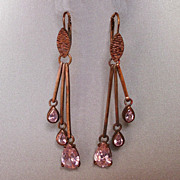 Seventies chandelier earrings copper tone metal pink zircon drops