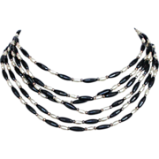 Three strand elongated  black and white beads necklace