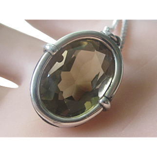 Beautiful Oval Faceted Smokey Topaz In Sterling Silver Bezel