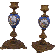 A Pair of French Gilt Bronze and Porcelain Candle Sticks