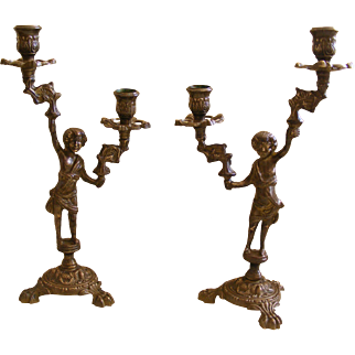 A Pair of French Bronze Figure Candle Sticks