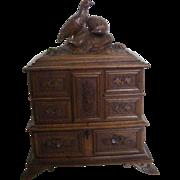 A Black Forest Oak Jewellery Box with Birds