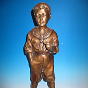 Tall bronze figure of a young boy 20th Century.