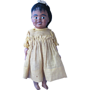 Black Composition Doll with Glass Eyes