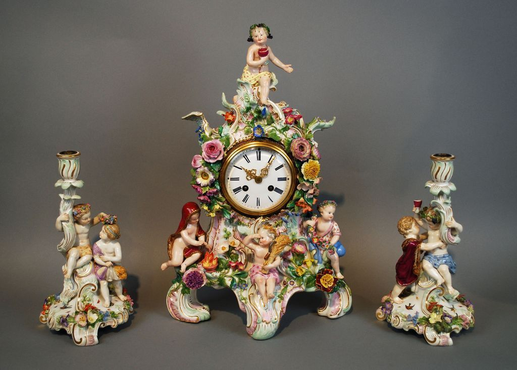 Antique Meissen Four Seasons Porcelain Clock Set with Pair of Candle Holders