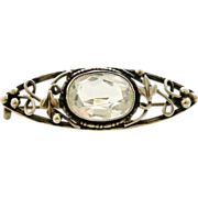 Arts and Crafts sterling silver rock crystal vine brooch