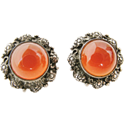 Vintage arts and crafts clip earrings in sterling silver and carnelian