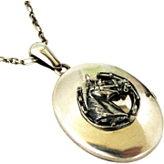 Victorian sterling silver locket with horse and horseshoe
