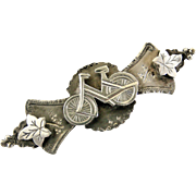 Victorian sterling silver sweetheart brooch , bicycle and ivy leaves.