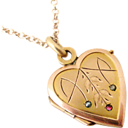 French art deco rose gold filled heart locket and chain, seed pearl and ruby.