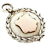 Vintage sterling silver and rose gold watch fob 1931