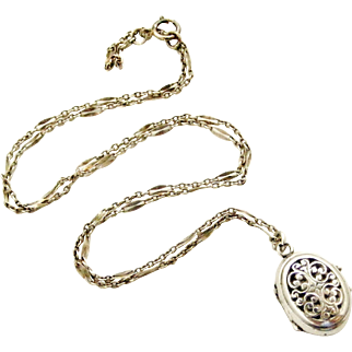 Tiniest antique silver embossed French locket and chain