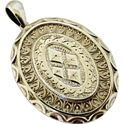 Antique Victorian large sterling silver locket in wonderful condition.