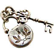 Delightful French silver padlock and key charm