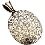 Large antique European 900 engraved silver locket