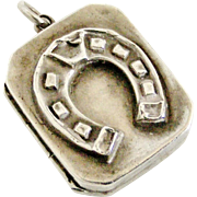 Antique sterling silver lucky horseshoe locket