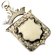 Edwardian antique sterling silver crown and shield watch fob medal.