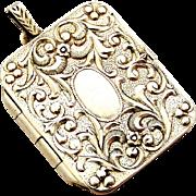 Vintage Continental 800 silver embossed book locket