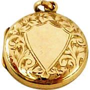 Antique Victorian 9k gold back and front hand engraved little round locket.