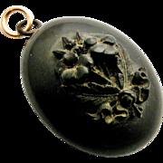 Antique Victorian black vulcanite locket with carved pansies