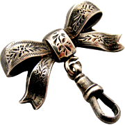 Victorian engraved sterling silver bow fob brooch for a watch or locket