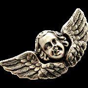 Victorian sterling silver cherub brooch