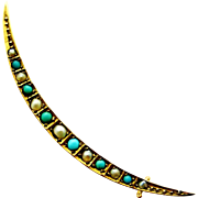 English antique natural turquoise and seed pearl crescent moon brooch in 9k gold.