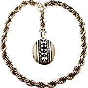 Victorian repousse sterling silver locket on thick sterling rope collar chain.