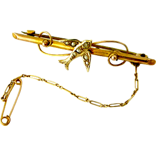 Pretty Edwardian swallow brooch in 9k gold and seed pearls
