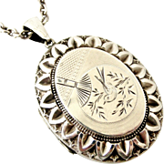 Victorian sterling silver aesthetic locket and chain, bird engraving