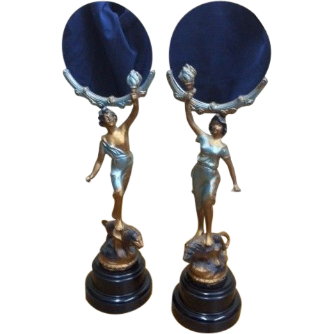 Decorative Pair of Mirrors held by Figures