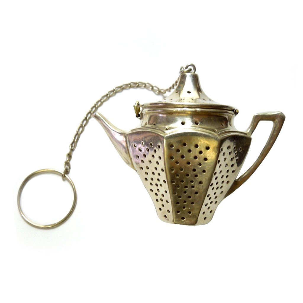 Vintage sterling figural tea pot strainer from
