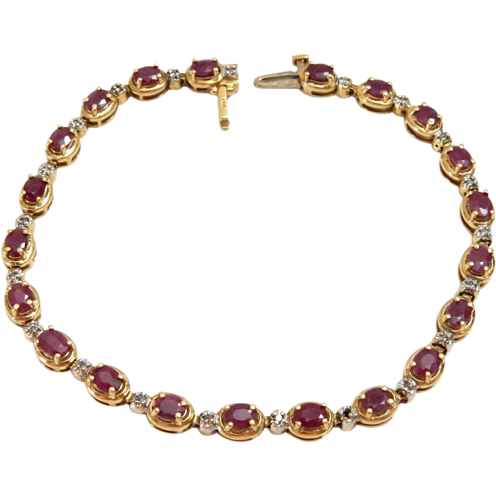 14k gold link bracelet with ruby and accents from